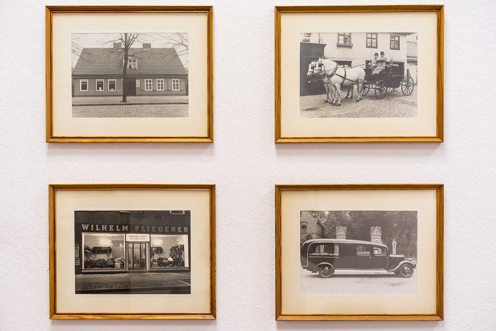 Historische Aufnahmen von Fliegener: das alte und das aktuelle Geschäft in Spandau, ein Leichenwagen und eine Pferdekutsche
