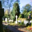 In Grabstein auf einem Friedhof