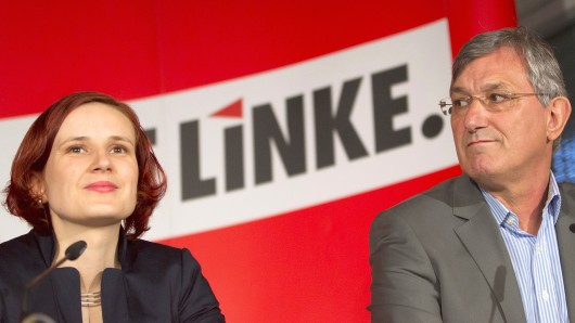 The new leaders of the left-wing Die Linke party Katja Kipping (L) and Bernd Riexinger present their 120-day-program during a news conference in Berlin, June 12, 2012. REUTERS/Thomas Peter (GERMANY - Tags: POLITICS) - RTR33H1Q