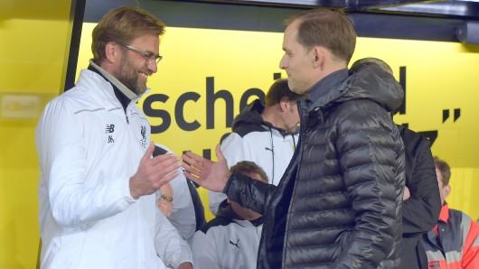 BVB-Trainer Thomas Tuchel  (r.) und Jürgen Klopp begrüßen sich